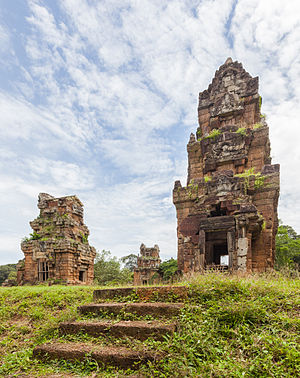 Three of the series of twelve towers of Prasat Suor Prat in Angkor Thom, former Khmer empire, today Cambodia. The towers, of unknown function, and built in the late 12th century, are made from rugged laterite and sandstone and are located in front of Terrace of the Elephants and Terrace of the Leper King.
