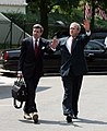 President George W. Bush and Ambassador Paul Bremer walk across West Executive drive outside the West Wing of the White House.jpg