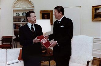 Soviet Military Power - SecDef Caspar Weinberger presenting President Ronald Reagan with the first copy of Soviet Military Power