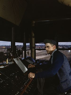 Classification yard - CNW towerman R. W. Mayberry operates the retarders at Proviso Yard in Chicago, Illinois, May 1943.