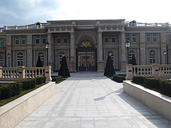 Putin palace main gate.jpg