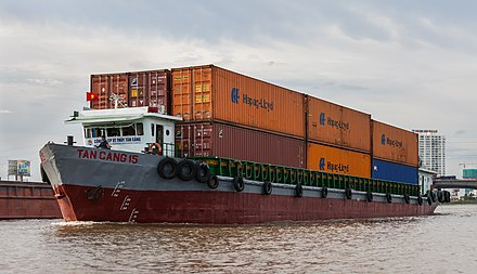 Container ship Tan Cang 15 in the Saigon river in Chi Minh City, Vietnam. - Container ship