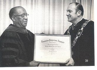Ralph Waldo Emerson Jones - R.W.E. Jones in 1969 receives the honorary LL.D. degree from Louisiana Tech University president F. Jay Taylor.