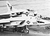 RA-5C and A-7E on catapults of USS Independence (CV-62) c1973.jpg