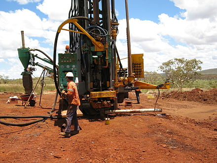 Drilling rig at the Area C iron ore mine, 95 km (59 mi) WNW of Newman, Western Australia. RC drill rig.jpg