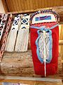 Red cradle board and white leggings with bead work.JPG