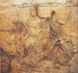 Northern and Southern dynasties - A scene of two horseback riders from a wall painting in the tomb of Lou Rui at Taiyuan, Shanxi, Northern Qi dynasty (550-577 AD)