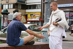 New religious movement - A member of the International Society for Krishna Consciousness proselytising on the streets of Moscow, Russia