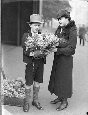 Wattle Day - Woman buying wattle for Wattle Day, Sydney, 1935