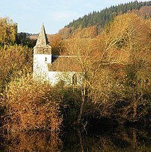 A church with autumn leaves and River Wye