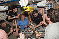 STS-133 ISS-26 crew members share a meal in the Unity node.jpg