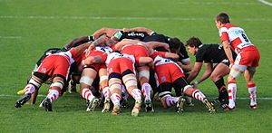 Scrum (rugby) - Luke Burgess (rightmost player in black) introduces the ball into the scrum.
