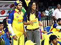 Sameera Reddy and Arya viewing CCL match, India.jpg