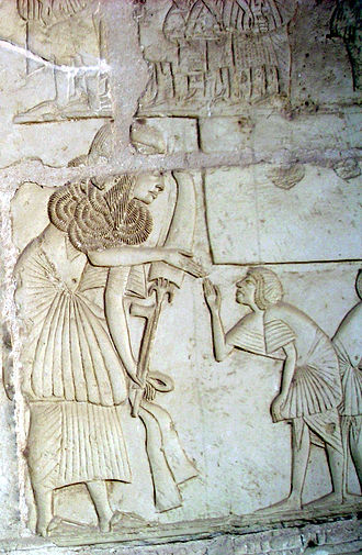 Horemheb - Relief from Horemheb's tomb. Receiving 'gold of honour' collars.