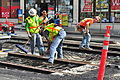Seattle - laying trolley tracks on Broadway at Pine 18.jpg
