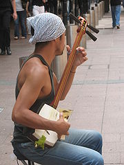 A busker playing a shamisen in Sydney, Australia
