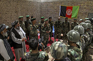 Nawa-I-Barakzayi District - Afghan National Army Brig. Gen. Sheer Mohammad Zazi speaks to Afghan National Army soldiers and local Nawa District officials at Patrol Base Jaker.