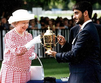 House of Al Falasi - Sheikh Saeed the Olympic athlete receiving a trophy from Her Majesty the Queen