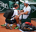 Simone Bolelli needed treatment from the trainer (8334043862).jpg