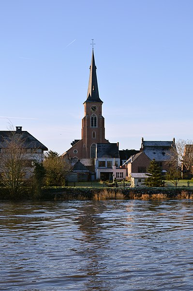 Sint-Gertrudis Church in Wichelen, seen from the opposite side of the Scheldt River.