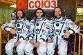 Soyuz TMA-19M crew in front of their spacecraft.jpg