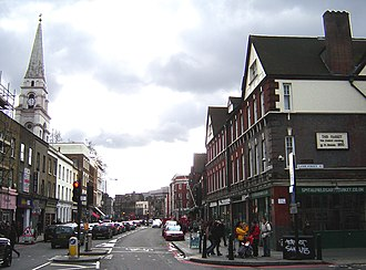 Commercial Street, London - Commercial Street, looking south. The spire of Christ Church is to the left, Spitalfields Market to the right. (February 2007)