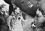 Squadron Leader Douglas Bader (centre) and fellow pilots of No. 242 Squadron, Flight Lieutenant Eric Ball and Pilot Officer Willie McKnight, admire the nose art on Bader's Hawker Hurricane at Duxford, October 1 CH1412.jpg