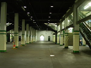 St James railway station, Sydney - Centre of the large island platform, showing part of the track space between the two island platforms as built, now filled in. The edge of the original island platform on the right is visible near the centre of the photograph. The walls at the far end are of temporary construction: doors give access to the disused sections of the central platforms and rail tunnels.