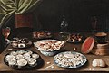 Still life with various vessels on a table, by Osias Beert.jpg