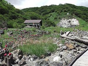 """Sessho-seki - Image: Stone Jizos (stone statues of Kshitigarbha) in front of the """"Sessho seki""""(Killing Stone),Nasu,Tochigi, Japan"""