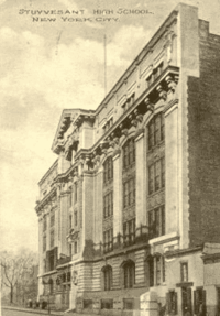 A grayscale postcard showing the Old Stuyvesant Campus in Manhattan's East Village. The postcard's vantage point is from down the street from the old building, and depicts the five-story stone facade of the building.