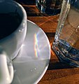 Sunlight dispersed by glass of water.jpg
