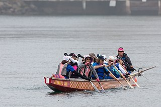 Breast cancer survivors dragon boating