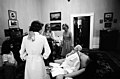 Susan Ford and an Unidentified Child Look At a Skeleton First Lady Betty Ford and her Secretary Nancy Howe Dressed for Halloween in the President's Private Study on the Second Floor of the White House - NARA - 12082678.jpg