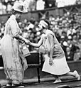 Suzanne Lenglen shaking hands with the Queen, 1926.jpg