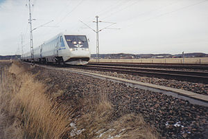 Ground vibration boom - Swedish high-speed train X 2000 approaching Ledsgard.