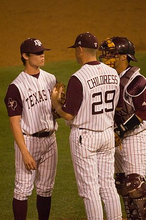 Texas A&M Aggies baseball - Head Coach Rob Childress on the mound, instructing an Aggie pitcher.
