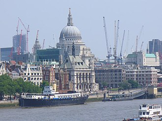 HMS President (1918) - A view of President with St Paul's Cathedral and the City of London in the background