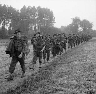 15th (Scottish) Infantry Division - Men of the 10th Battalion, Highland Light Infantry advance during Operation 'Epsom', 26 June 1944.