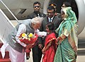 The Prime Minister, Shri Narendra Modi being welcomed by the Prime Minister of Bangladesh, Ms. Sheikh Hasina on his arrival, in Hazrat Shahjalal Airport, Dhaka on June 06, 2015 (1).jpg