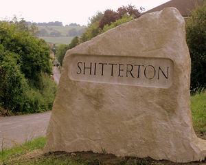 Street sign theft - The residents of Shitterton, a small village in Dorset, England, collectively purchased this large stone sign to deter frequent theft.