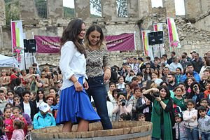 Grape stomping - Arianne Caoili (left) performing grape stomping during the 3rd Annual Wine Festival in Artsakh