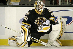 English: Tim Thomas stretching before a game o...
