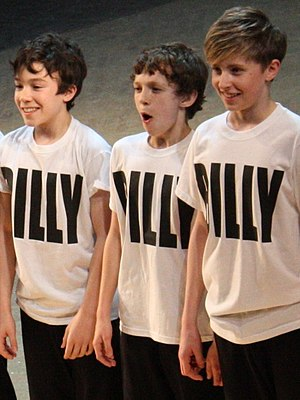 Tom Holland (actor) - Holland (centre) performing at the fifth anniversary of Billy Elliot the Musical, 31 March 2010