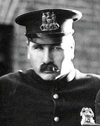 Tom Wilson as the cop in The Kid (1921).jpg