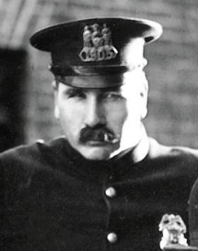 Tom Wilson as the cop in The Kid (1921).jpg