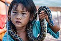 Tonle Sap Siem Reap Cambodia Girl-begging-for-money-with-snake-01.jpg
