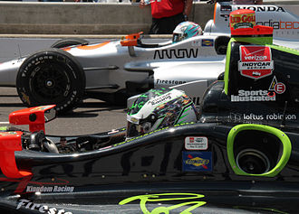 Townsend Bell - Bell (foreground) participating in the Pit Stop Challenge on Carb Day at the 2015 Indianapolis 500