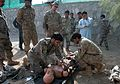 Training trainers, Afghan police lifesavers practice medical skills to teach to comrades 131022-Z-SW098-316.jpg