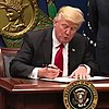 Trump signing order January 27 (square crop).jpg